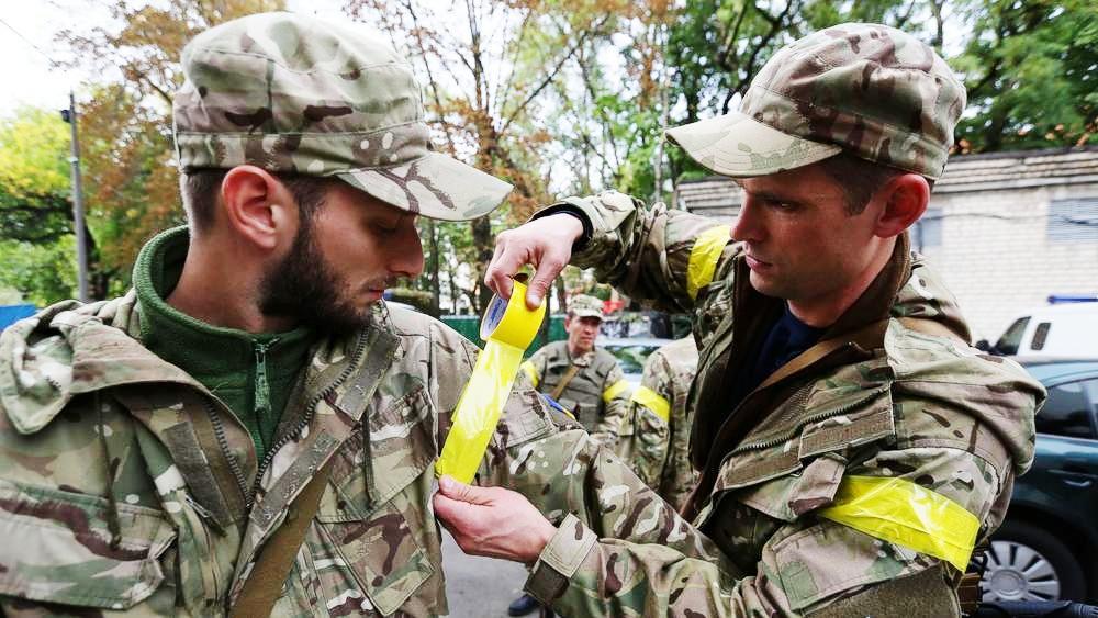 Украинские солдаты сражаются вопреки